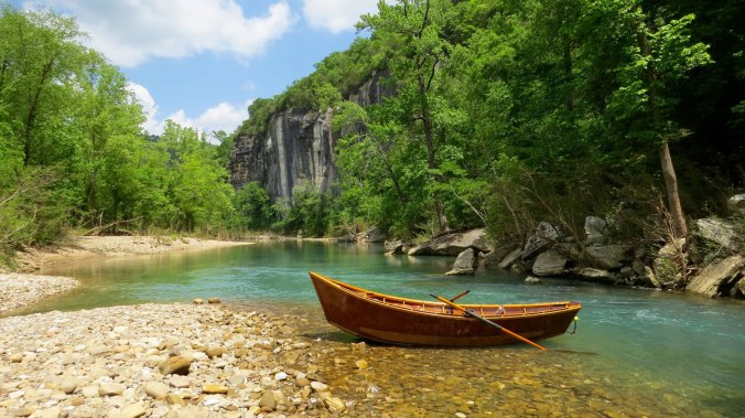 Greh Hatten's wooden boat waiting on the banks of the Buffalo National River