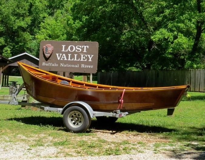 Greg Hatten's wooden boat on the trailer at the entrance to Lost Valley, before he takes on the Buffalo River.