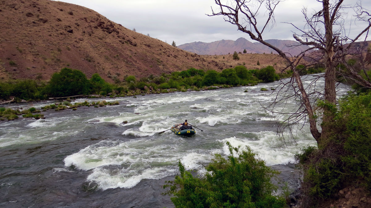 A rafter on the rapids of Oregon's Deschutes River. Photo by Greg Hatten