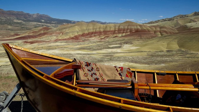The Painted HIlls blanket by Pendleton, at Oregon's Painted Hills. Photo and hand-built wooden boat by Greg Hatten