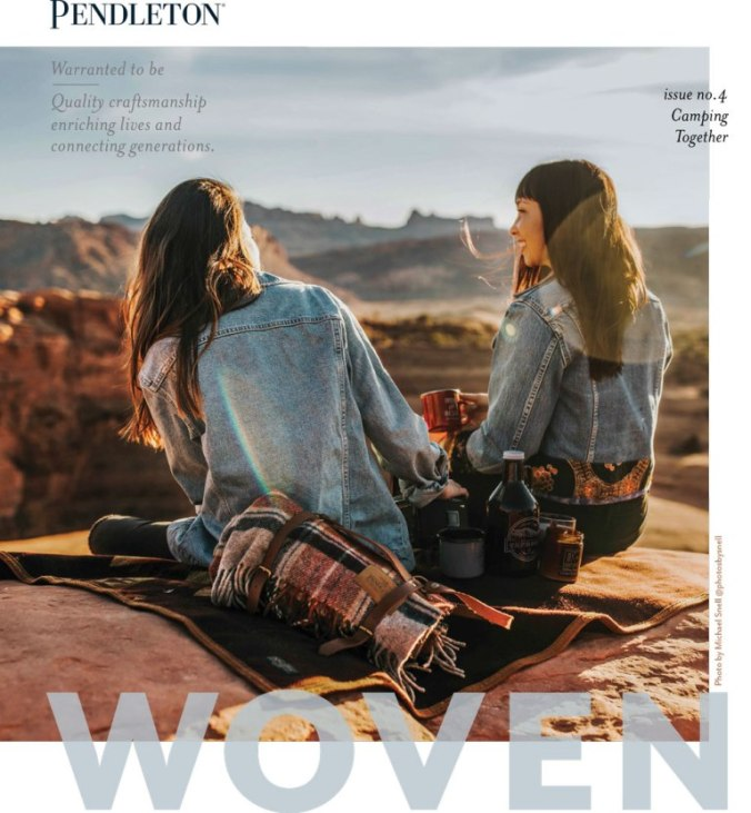 Pendleton WOven magazine cover for Spring 2019, two young women sit on a Pendleton plaid throw, overlooking a red rock canyon.