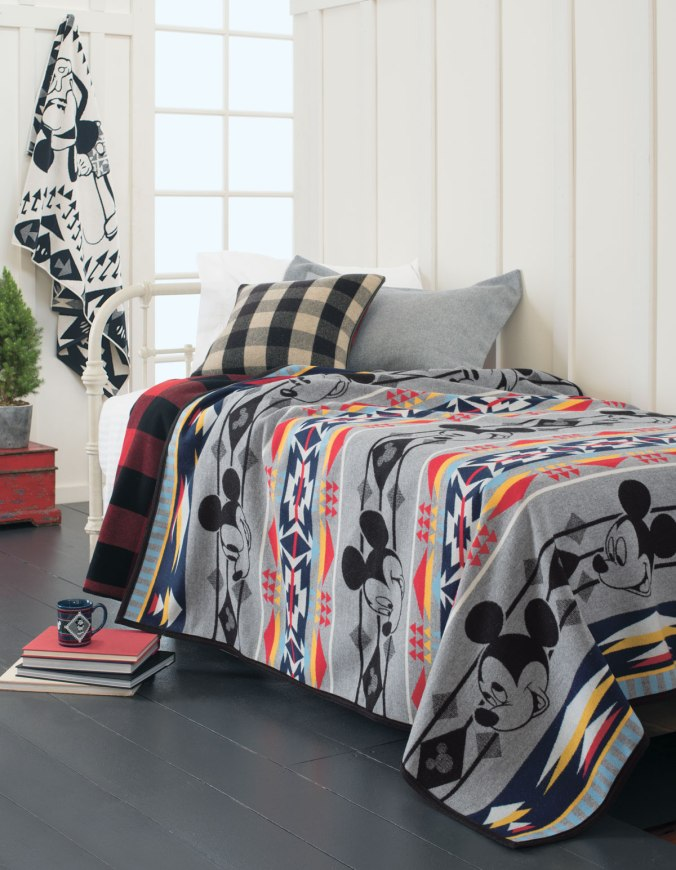 Pendleton Mickey Mouse blanket on a bed.