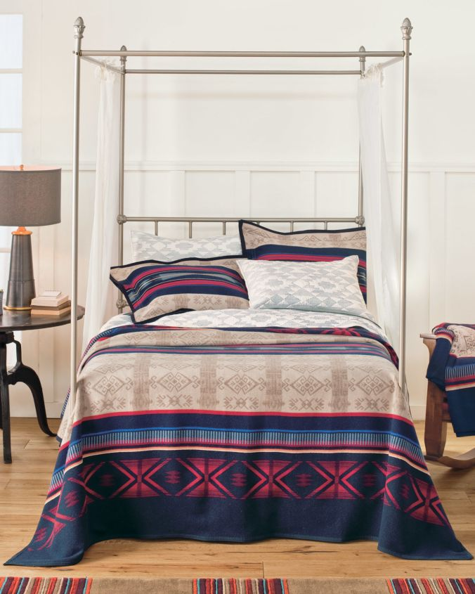 The Bighorn blanket, by Pendleton, shown on a bed.