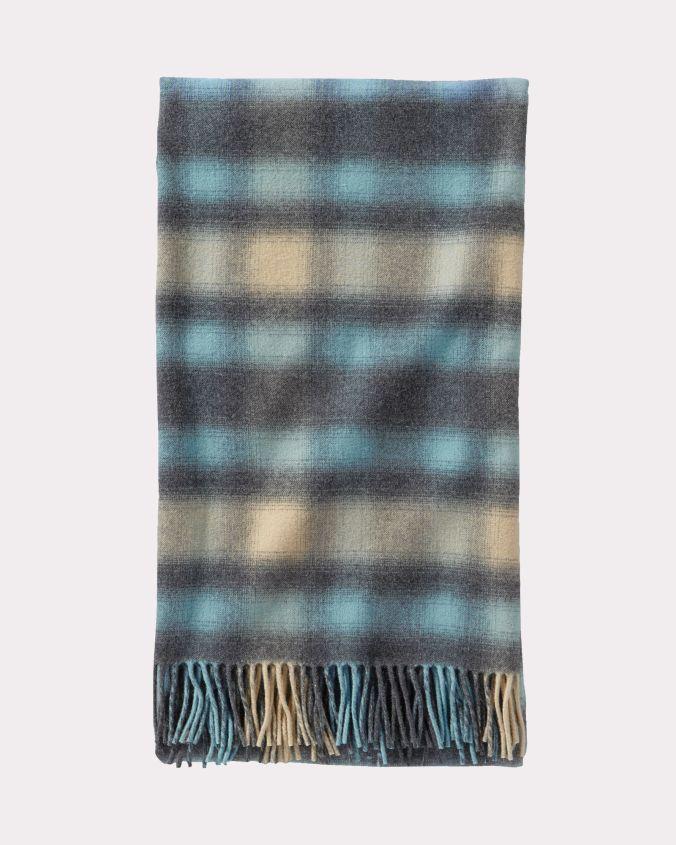 A folded Pendleton 5th Avenue throw in a soft blue plaid.
