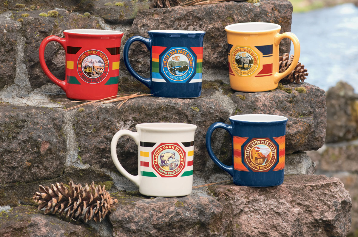 Pendleton's oversized mugs, emblazoned with the labels and stripes of  Pendleton national Park blankets, are set out on a rustic set of steps made from weathered bricks.