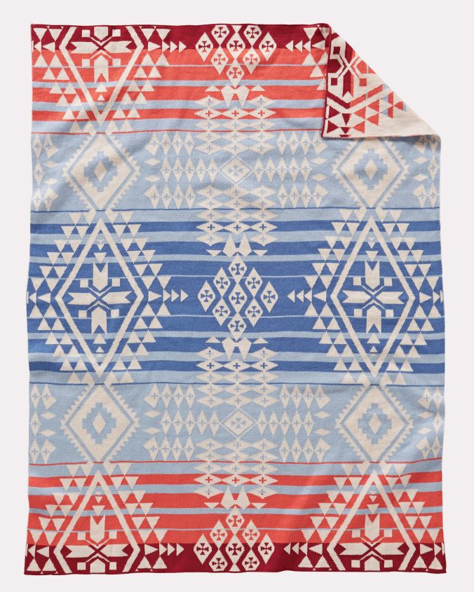 A knitted cotton Pendleton baby blanket in the Canyonlands pattern.