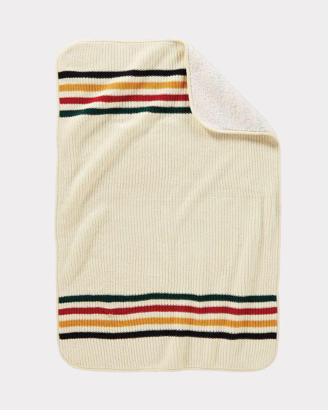 The knitted Pendleton stroller blanket in Glacier national park pattern.