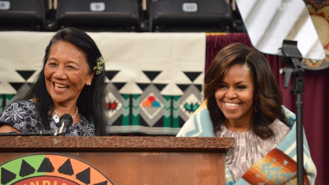 "First Lady Michelle Obama is robed with a ""Chief Joseph"" blanket at Santa Fe Indian School, 2016"