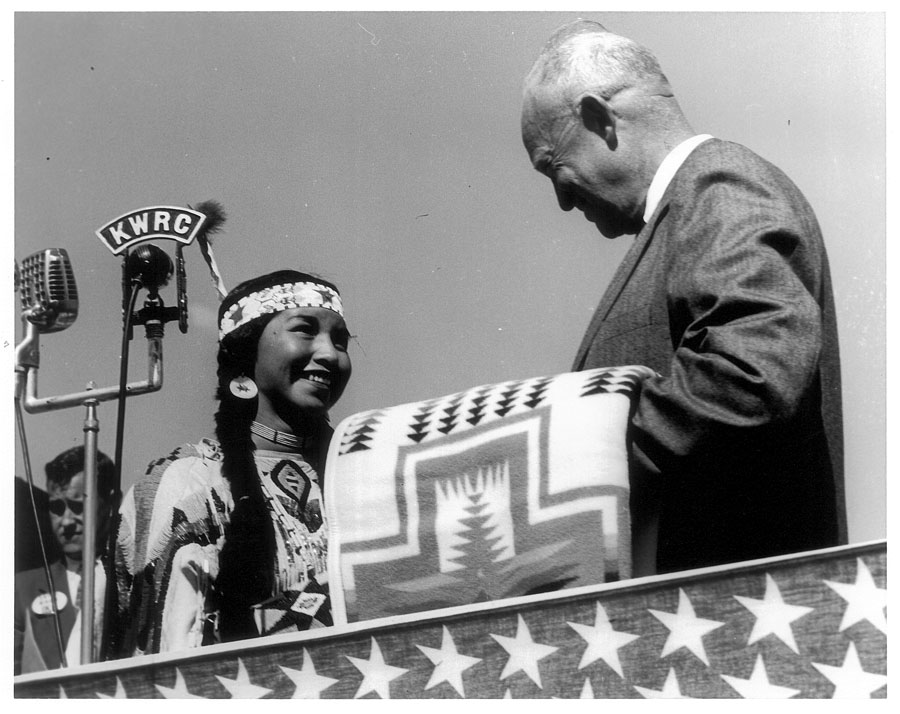 """President Dwight Eisenhower accepts a """"Harding"""" blanket during the dedication ceremony for McNary Dam in eastern Oregon, 1954"""