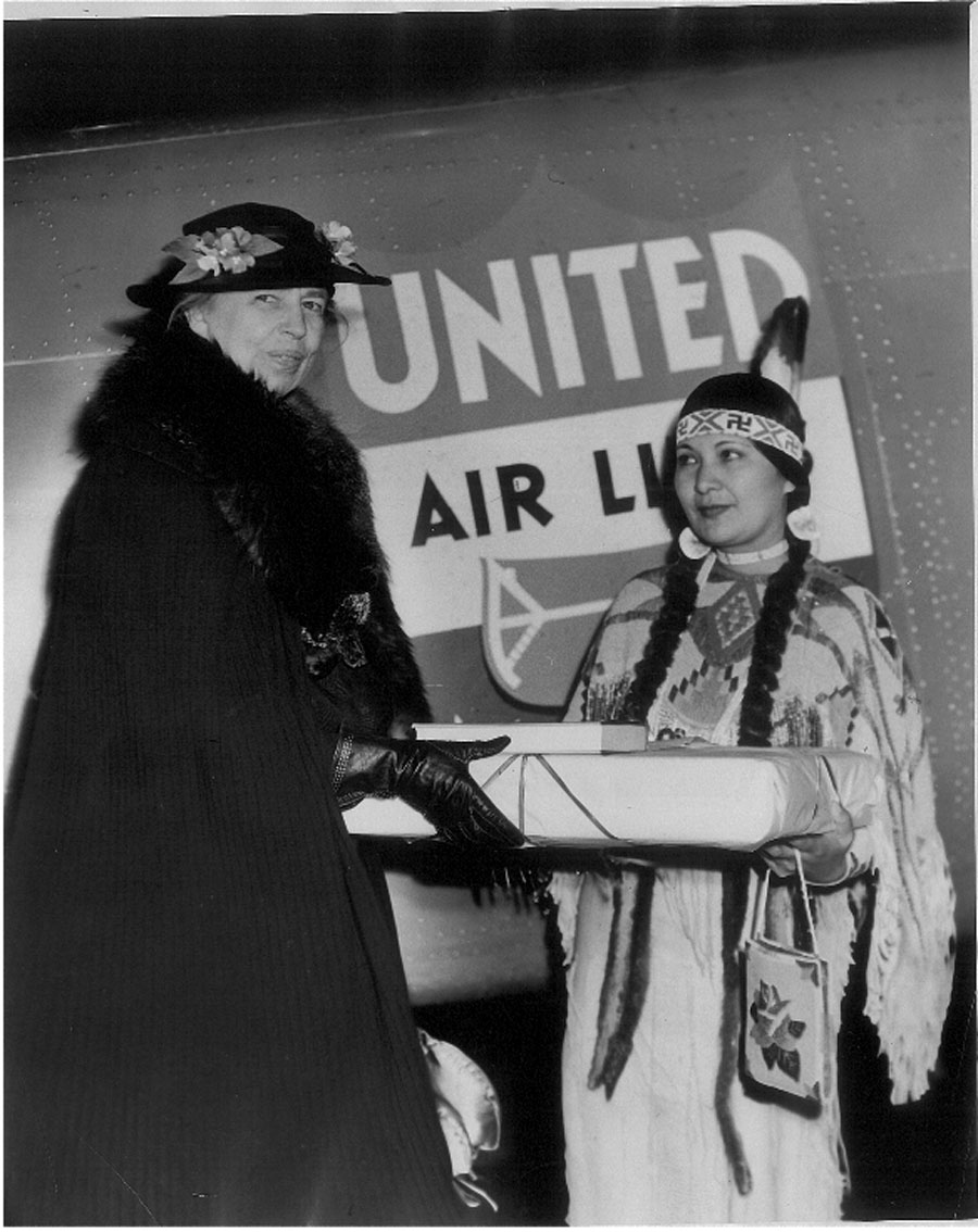 First Lady Eleanor Roosevelt accepts a Pendleton blanket (about 1941).