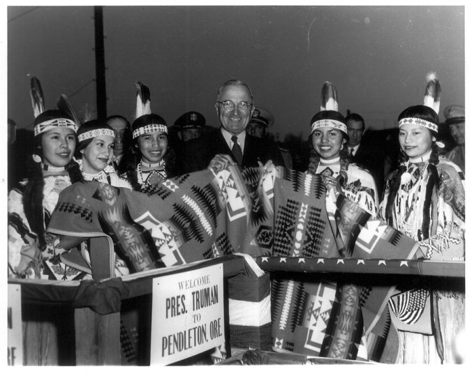 "President Harry Truman receives a ""Chief Joseph"" blanket while on tour in Pendleton, Oregon, 1950."