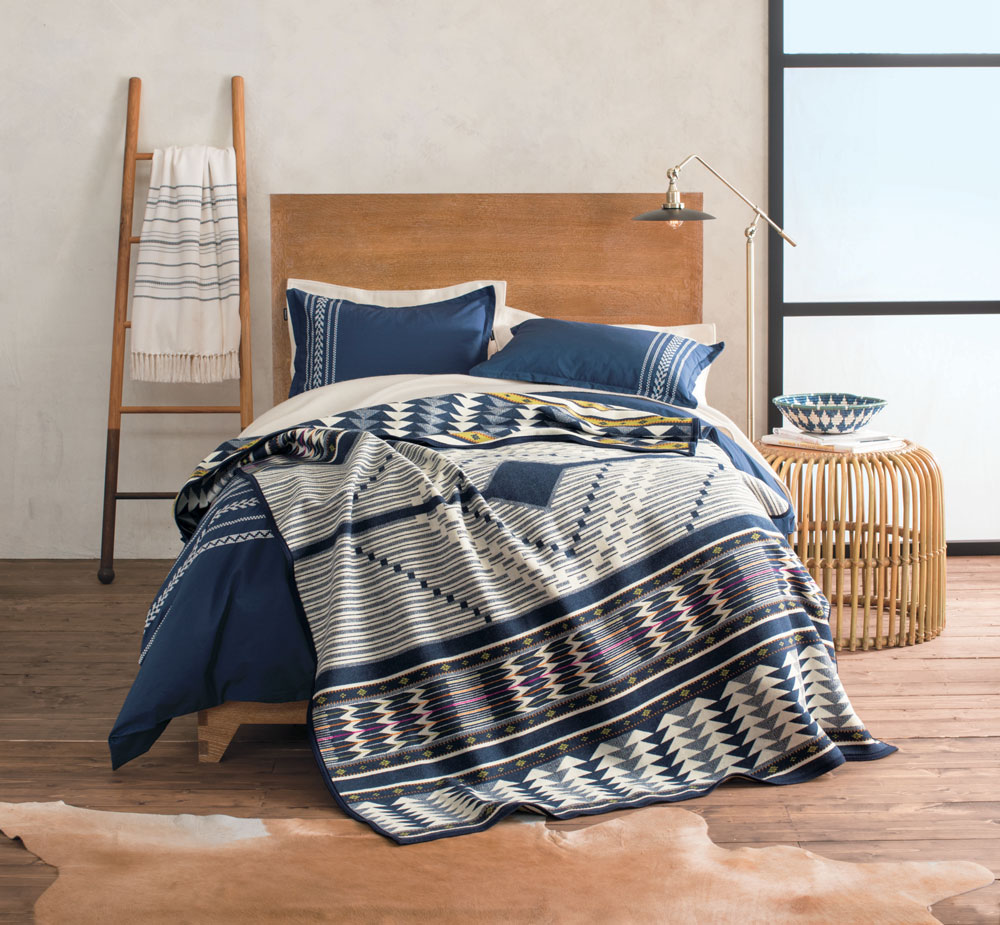 A bed made up with the Pendleton Spirit Seeker blanket.