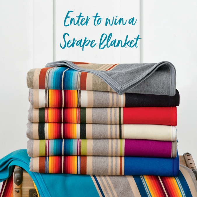 "A stack of colorful serape blankets, with the words ""Enter to win a serape blanket"""