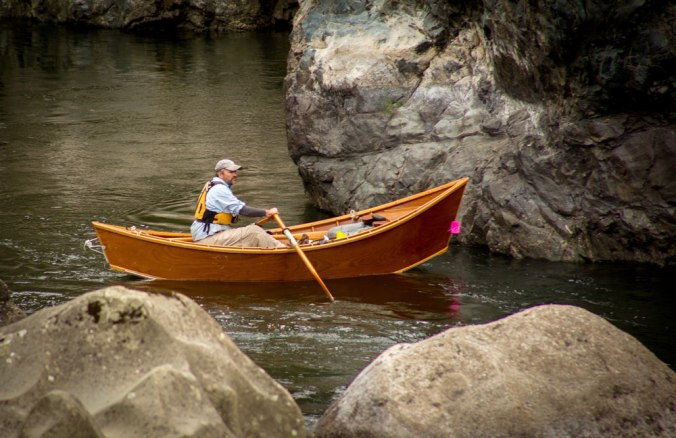 Greg hatten steers his wooden drift boat through a gentler part of the Rogue River.