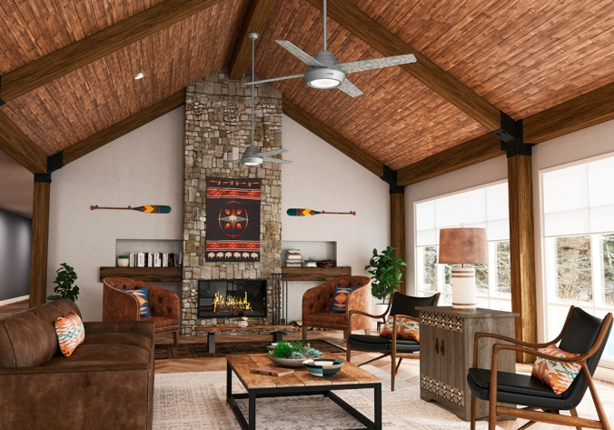 A living room with soaring wood-covered ceilings features the the silver Pendleton x Hunter fan. A stone fireplace at one end features the Pendleton Big Medicine blanket.