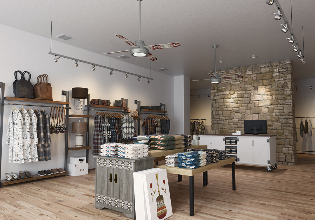 A boutique selling floor featuring the silver Pendleton x Hunter fan with the Canyonlands pattern. The boutique has white walls, wood floors, and a stone wall behind the cash wrap.