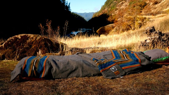 The Olympic National park blanket by Pendleton on a Therm-a-Rest Cot, made up on a patch of dry ground in Oregon.