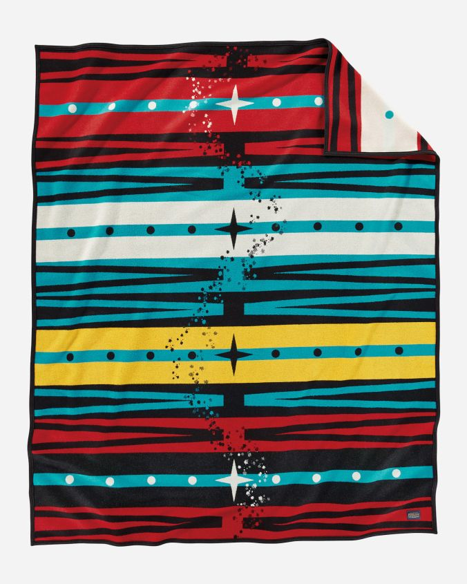 Pathway, a Pendleton blanket for the American Indian College Fund, designed by Bunky Echo-Hawk. Bands of red, yellow, , white, turquoise and black are crossed by a scattering of stars that form a pathway.