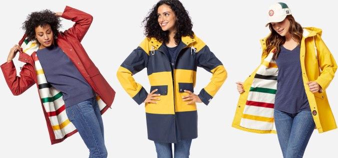 Three women pose in the studio, wearing Pendleton rain slickers.