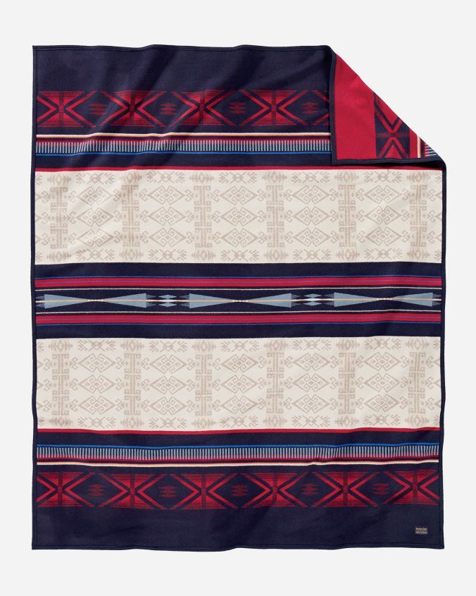 The Bighorn blanket, by Pendleton Woolen Mills. This design is a geometric pattern of navy blue, red, and tan.