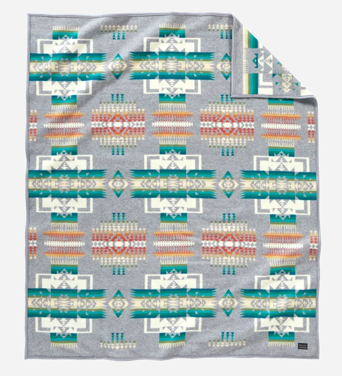 The Chief Joseph blanket in grey, turquoise, green, white, and orange,by Pendleton