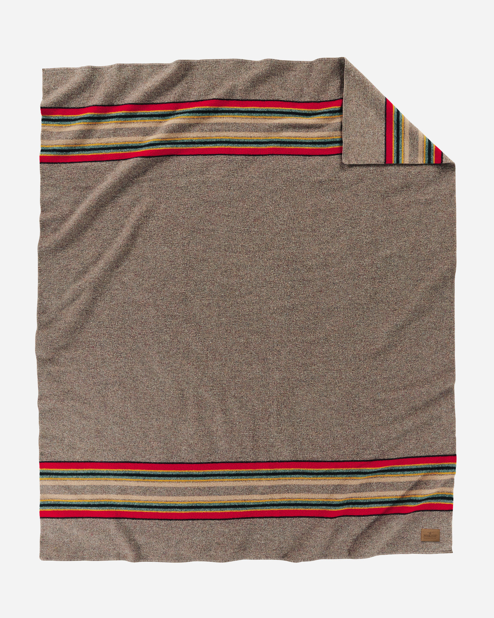 A Yakima Camp blanket in heathered taupe, with bands of red, green and tan at each end. By Pendleton.