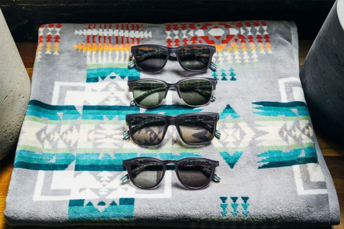 Four pair of Pendleton x Shwood sunglasses rest on a folded Chief Joseph towel, by Pendleton.