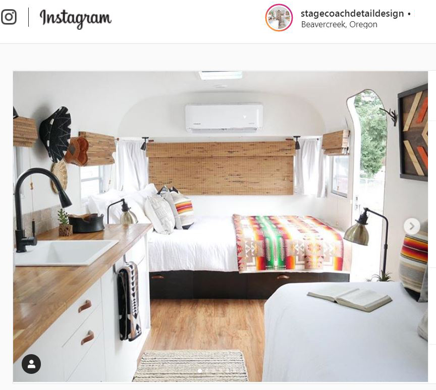 A bed in a restored vintage Airstream trailer with a Pendleton Chief Joseph blanket.