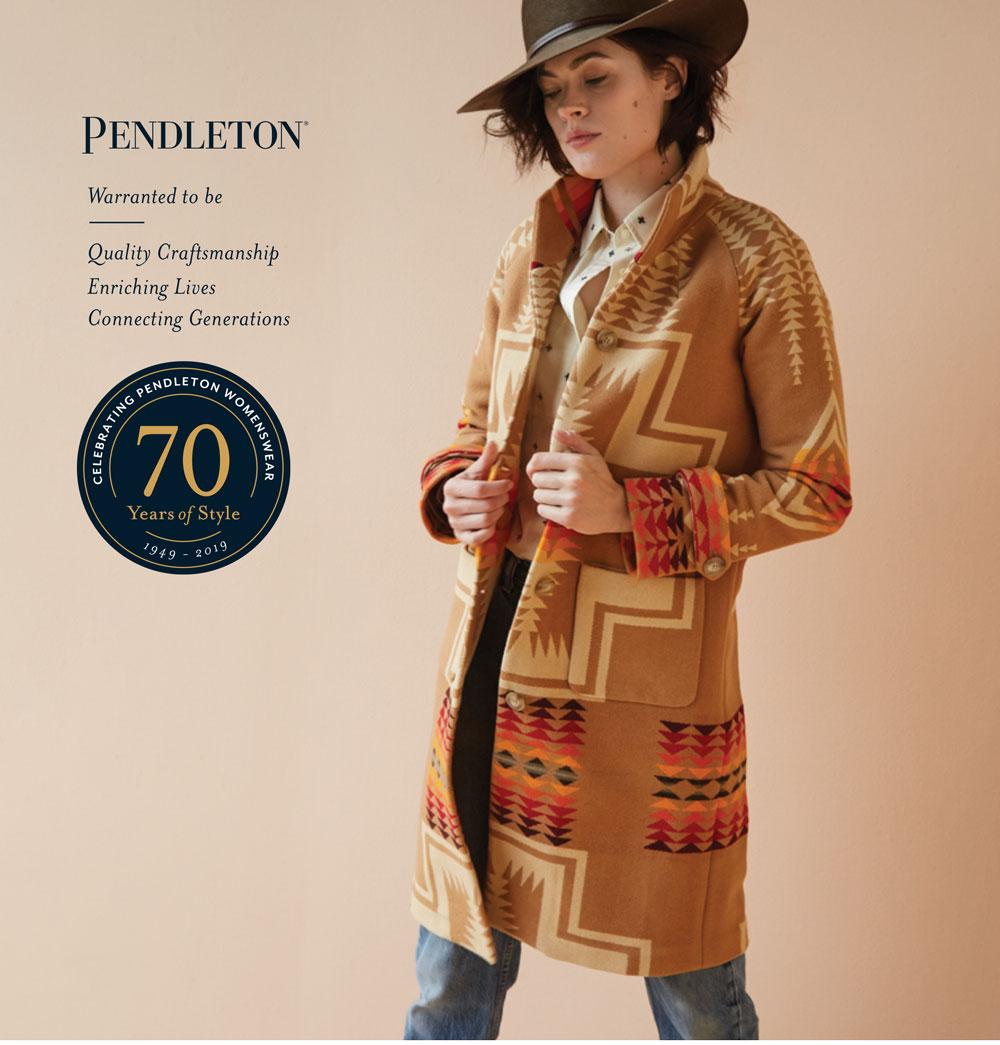 woman wearing hat and wool blanket coat by Pendleton