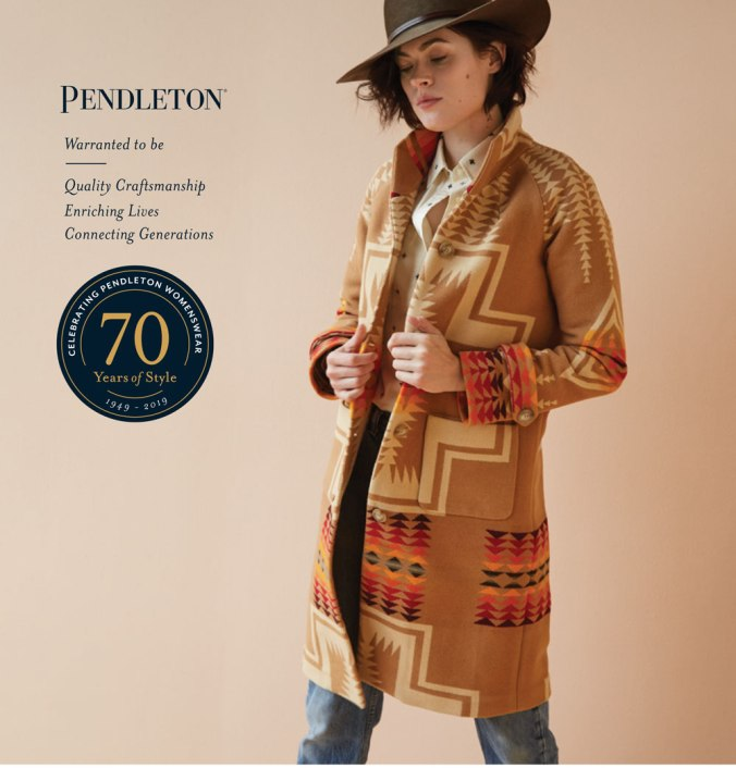 woman wearing hat and wool blanket coat by Pendleton