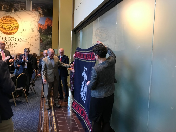 Former Oregon Governor Ted Kulongoski receiving a Pendleton Marines blanket at the Oregon Historical Society