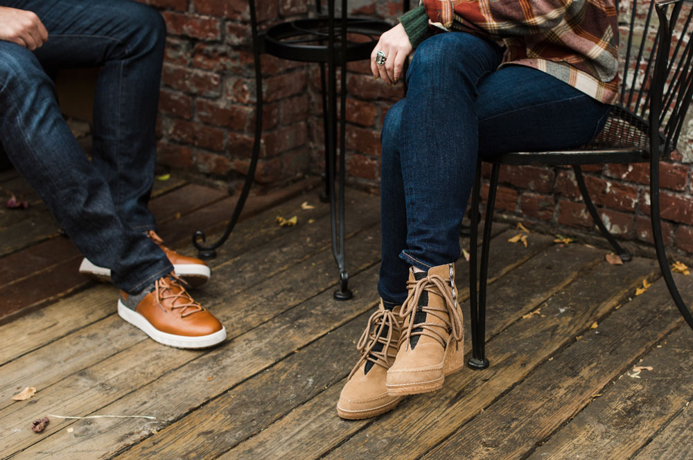 Man and woman sitting at table wearing Pendleton shoes/boots.