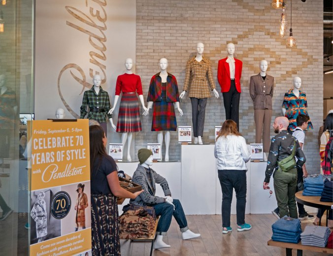 interior of Pendleton store with row of mannequins wearing vintage Pendleton women's clothing