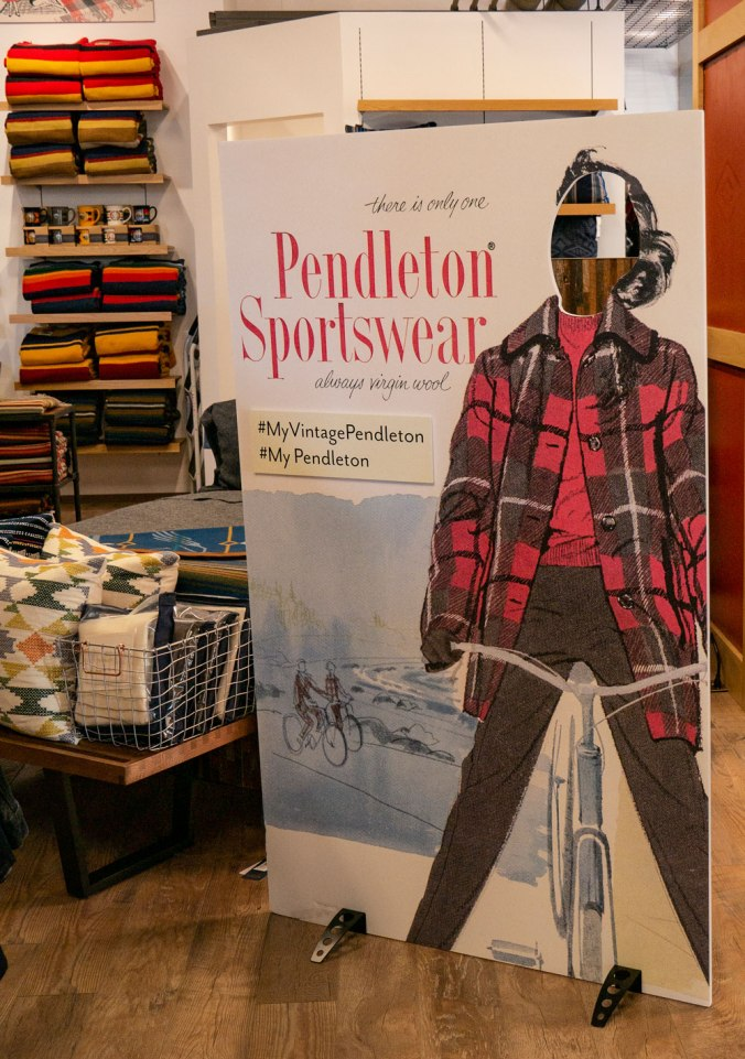 vintage pendleton ad of woman on bicycle placard with hole in face area where customers can put their own faces