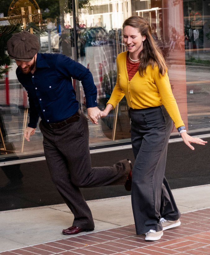 Lindy Hop dancers on sidewalk in front of Pendleton store, dancing, one woman, one man