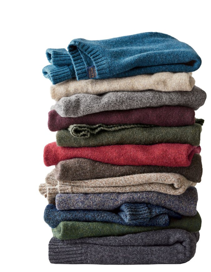 stack of folded men's Shetland sweaters by Pendleton