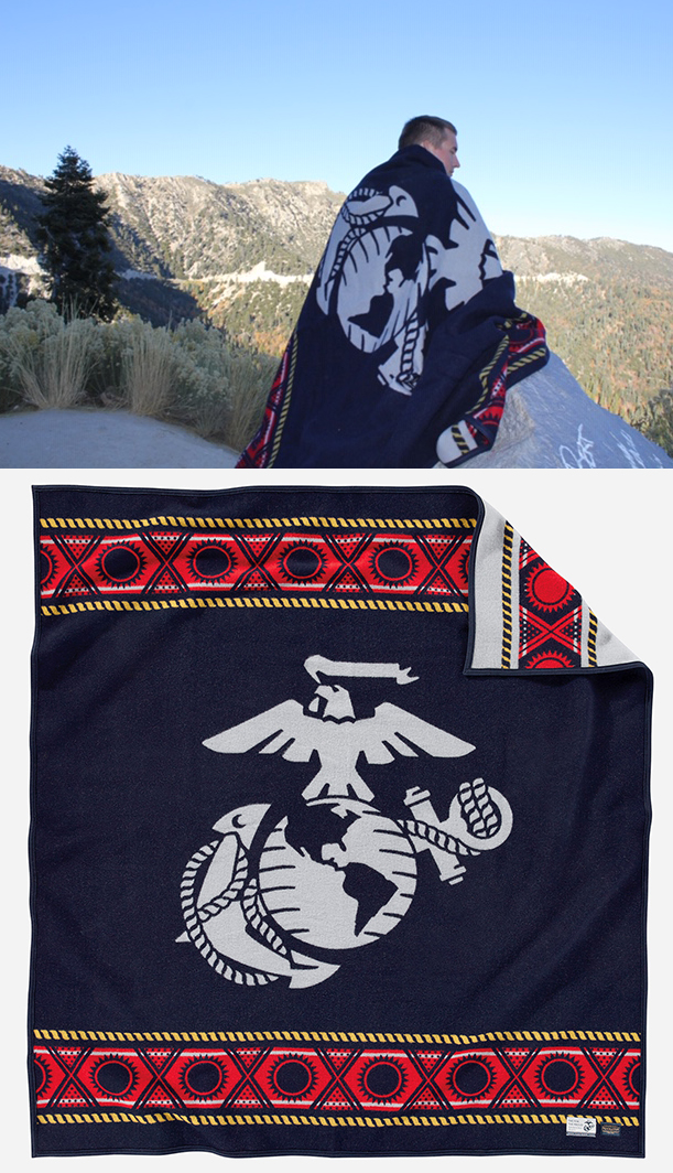 Man stands on hilltop with USMC Pendleton blanket.
