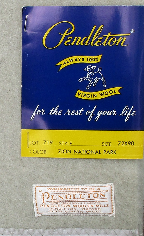 1950s Pendleton Zion Park blanket with cardboard tag and white and gold Pendleton label.