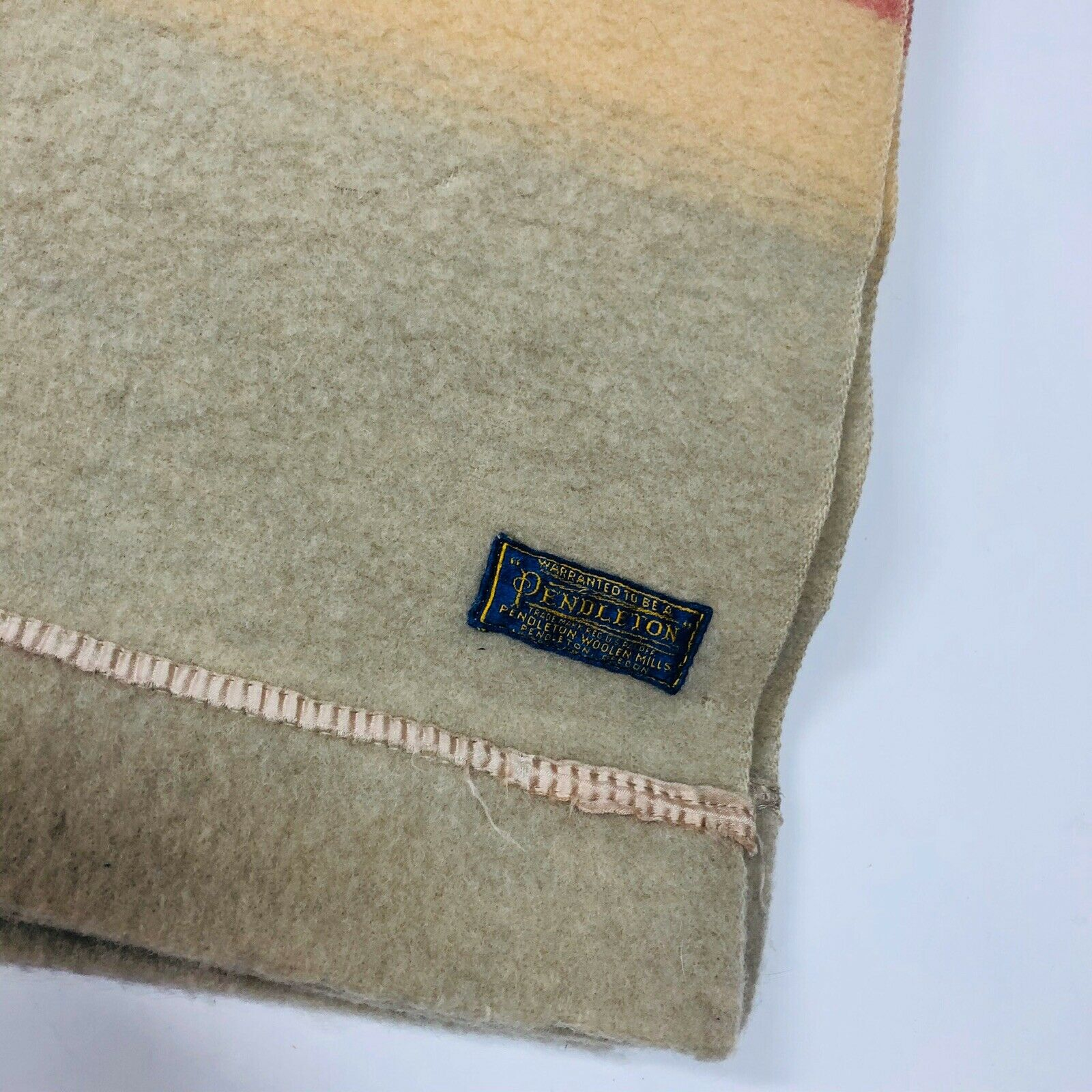 The corner of the 1940s version shows a blue and gold embroidered Pendleton label.