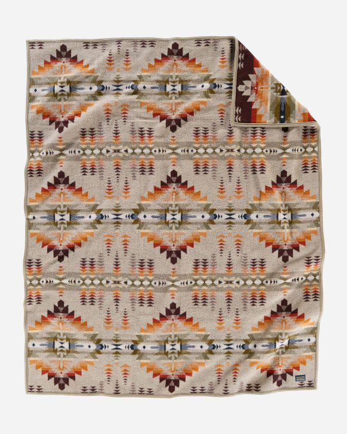 Juniper Mesa blanket by Pendleton - beige background with earthtone diamond designs