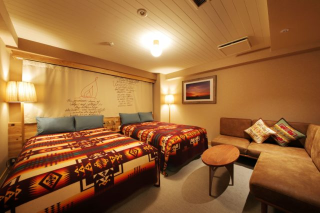Another room at Hotel Unwind in Sapporo, Japan, featuring Pendleton Chief Joseph blankets and pillows.