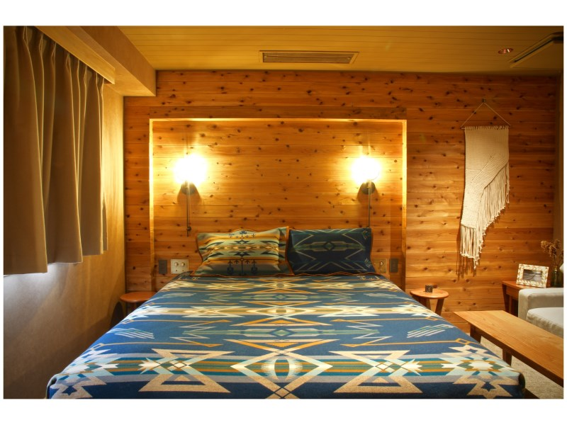 A  luxurious and rustic room at Hotel Unwind in Sapporo, Japan, featuring a Pendleton Star Watchers blanket.