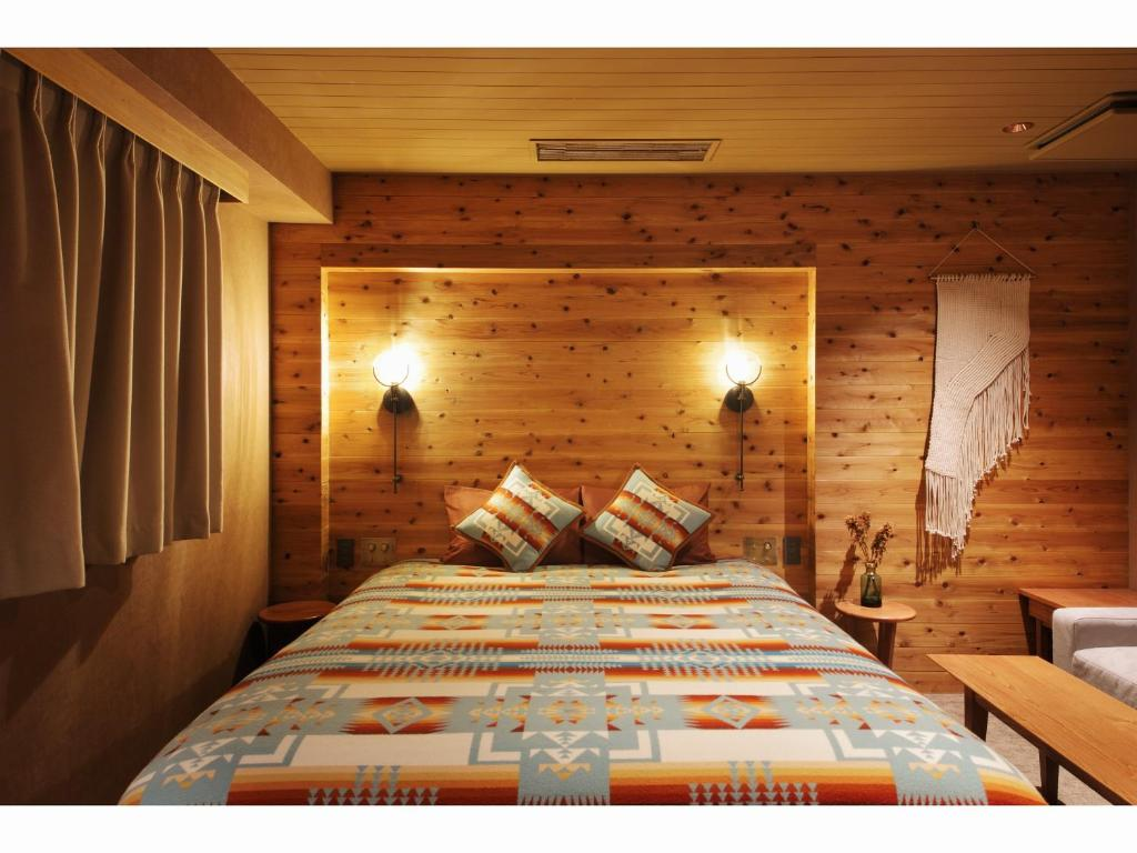 Another lodge-themed room at Hotel Unwind in Sapporo, Japan, featuring a Pendleton Chief Joseph blanket.