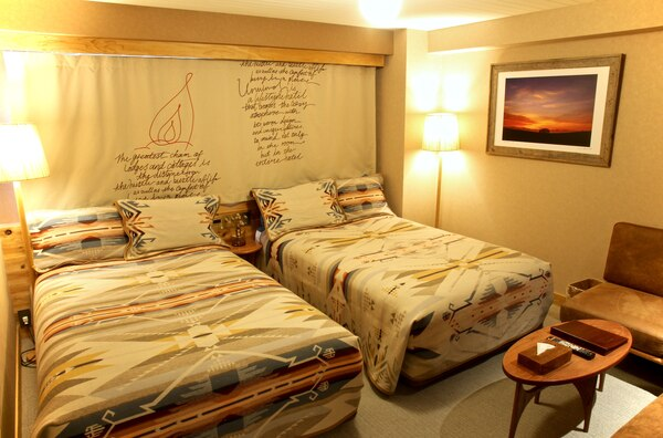 A room at Hotel Unwind in Sapporo, Japan, featuring a White Sands Pendleton blankets and pillow shams.